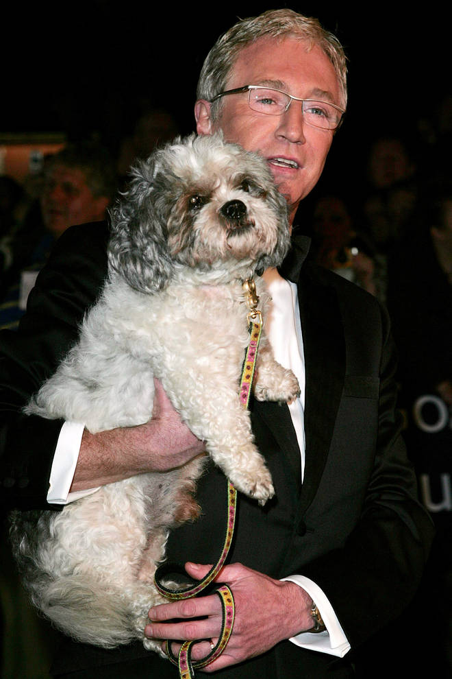 Paul O'Grady - pictured with his previous dog Buster in 2005 - is mourning the death of his epileptic pet
