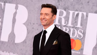 Hugh Jackman was all smiles as he arrived at the Brit Awards