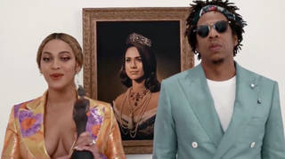 The couple posed with a portrait of Meghan Markle in full regal garb