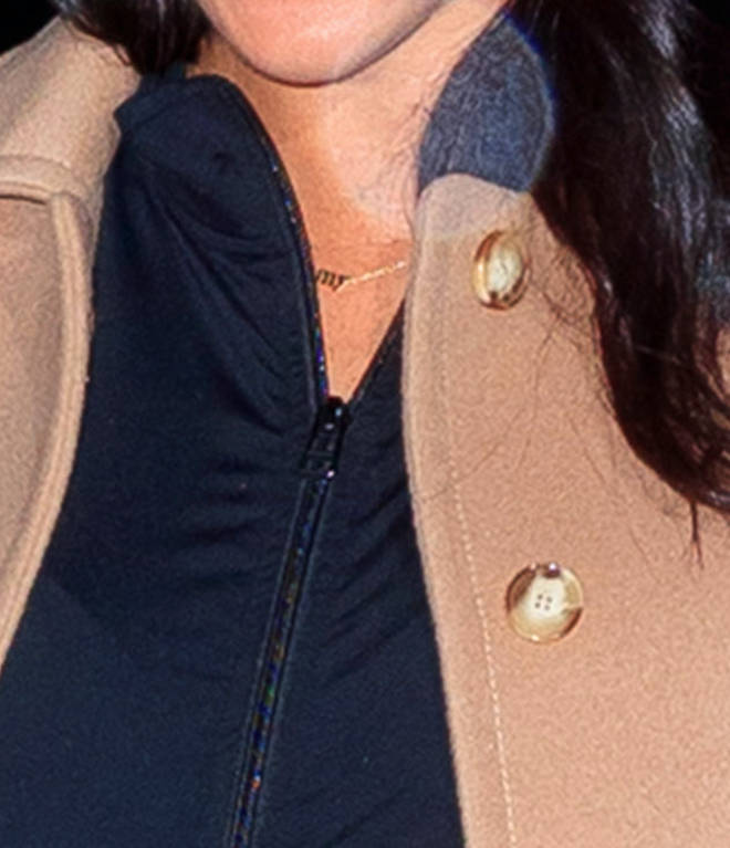 "The ""mommy"" necklace could be seen under the Duchess of Sussex&squot;s jacket"