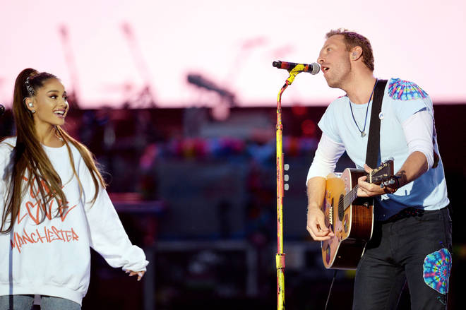 Ariana Grande performing with Chris Martin from Coldplay at One Love Manchester