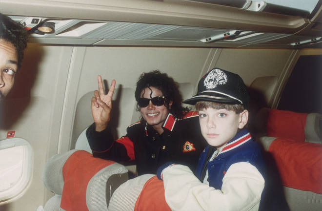 Michael Jackson with 10 year old Jimmy Safechuck on the singer's tour plane