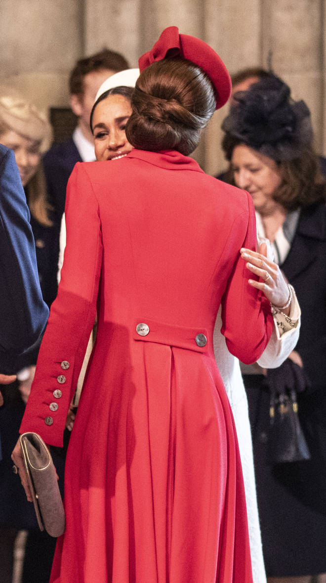 Meghan Markle and Kate Middleton greet each other with a kiss