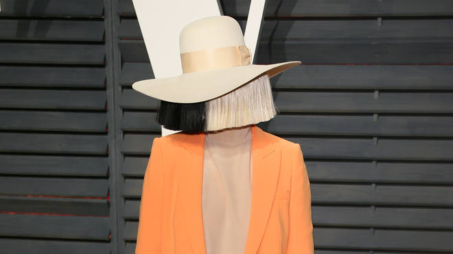 Sia usually covers her face while attending red carpet events
