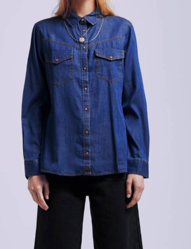 Kelly's denim shirt is by Zara