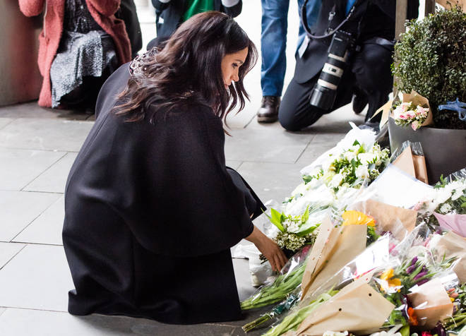 Meghan laid flowers before signing a book of condolence for the victims of the terror attack