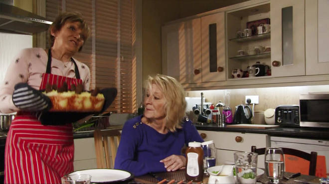 Jean Slater dishes up sausage surprise for Shirley Carter