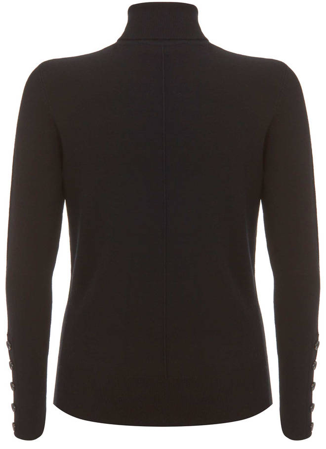 Kelly's roll neck jumper is by Mint Velvet