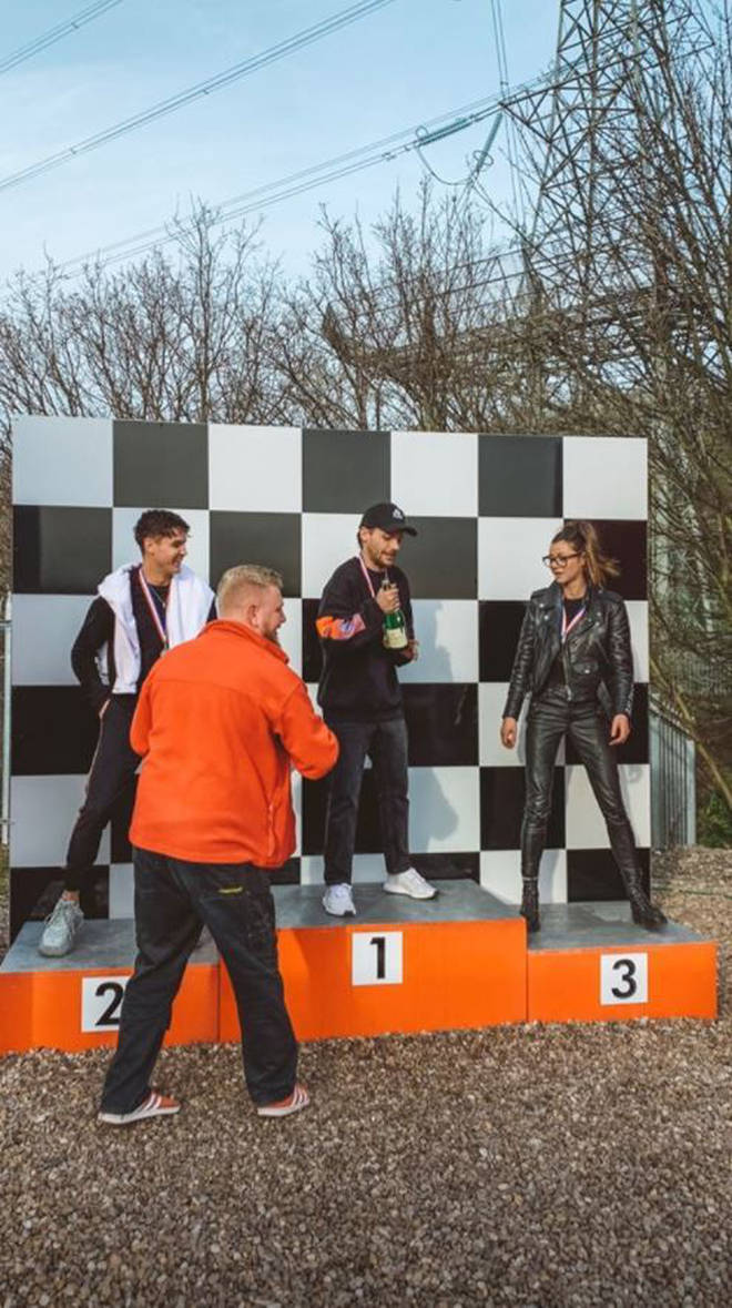 Louis Tomlinson celebrates Phoebe and Daisy's 15th birthdays at a go-karting track