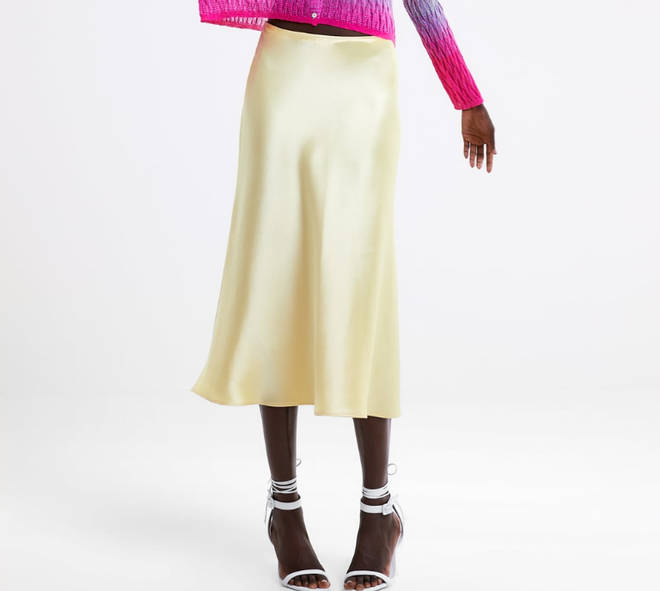 Kelly's satin midi skirt is from Zara
