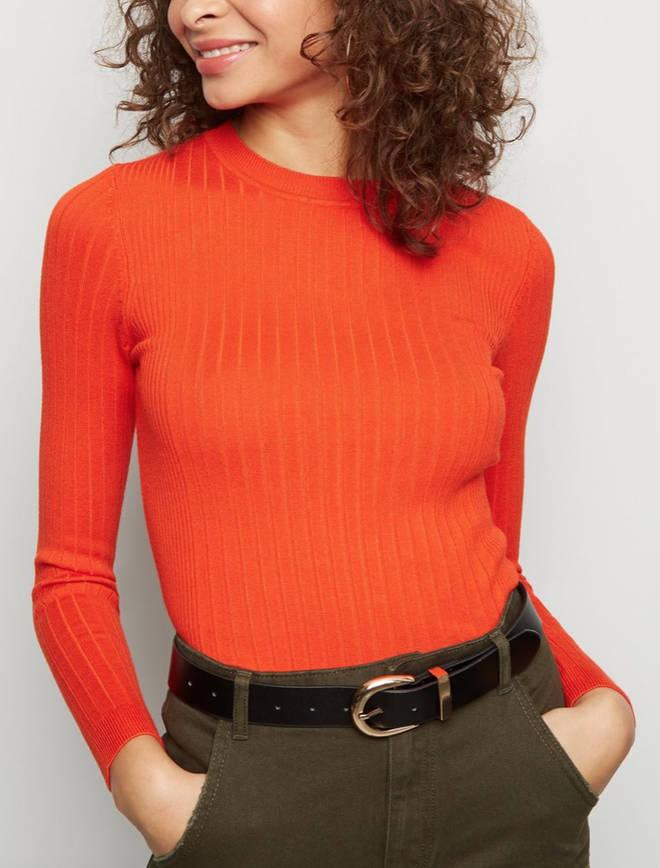 Kelly kept warm in an orange jumper by New Look
