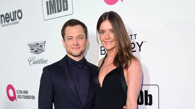 Taron Egerton and Emily Thomas attend the 27th annual Elton John AIDS Foundation Academy Awards Viewing Party
