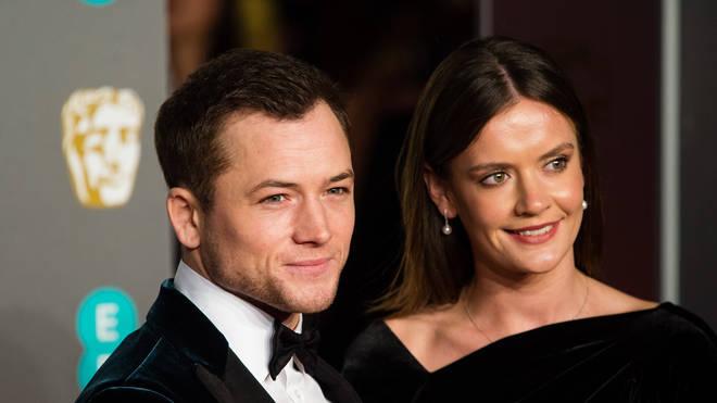Egerton with Emily Thomas at the 2019 BAFTAs