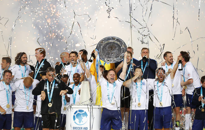 Robbie Williams and Olly Murs lift the trophy after winning the Soccer Aid for UNICEF 2018 match