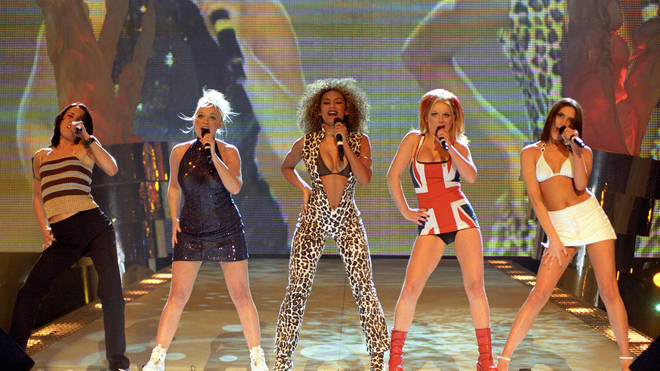 The Spice Girls performing in their iconic outfits at the 1997 Brit Awards