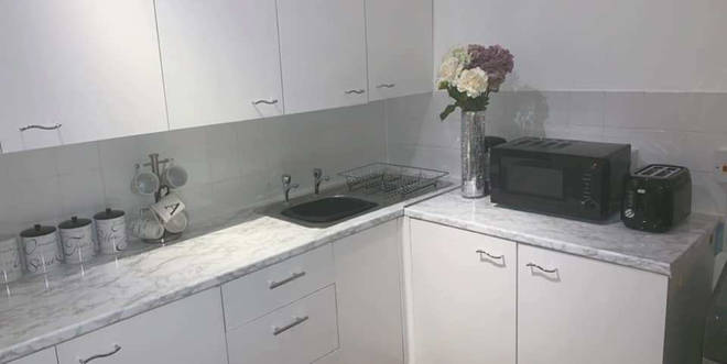 The vamped up marble kitchen was done on a tiny budget