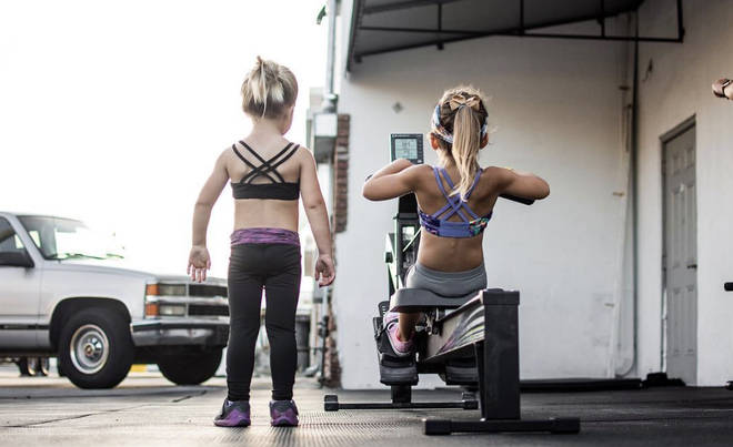 Two young girls were pictured wearing gym gear and working out