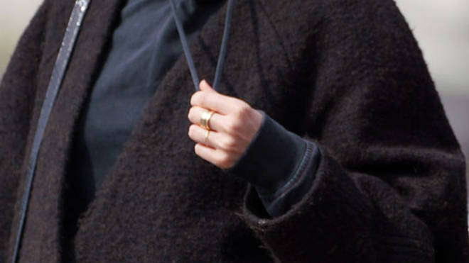 The gold ring on Stacey's finger is rather simple for an engagement ring, but anything is possible