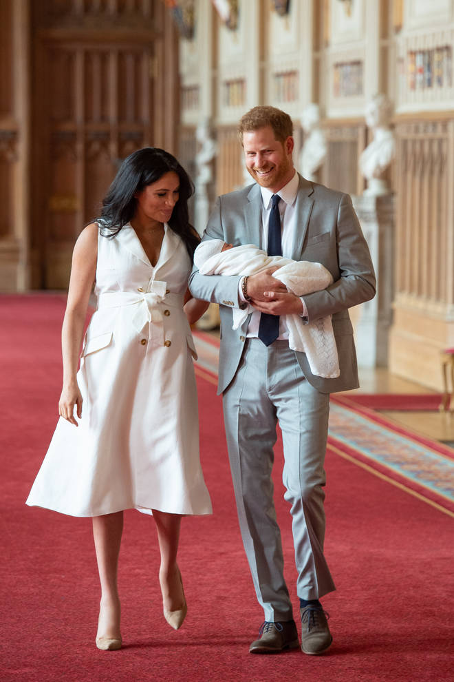 The royal couple beamed as they looked at their son