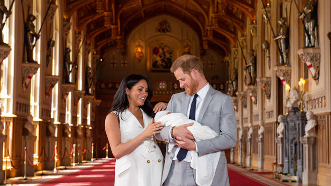 Meghan and Harry looked lovingly at their son