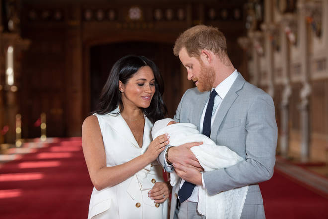 Meghan Markle checked on the little one as the photocall took place