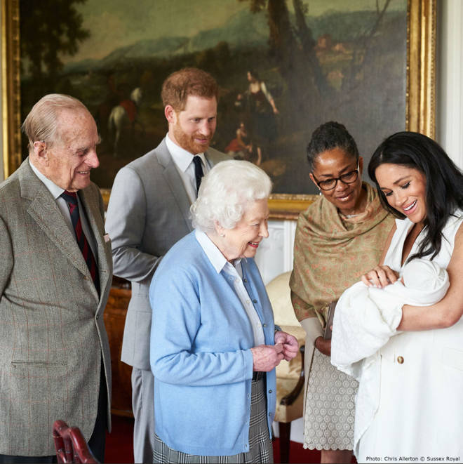 The Queen, Prince Philip and Doria Ragland look lovingly at the newborn