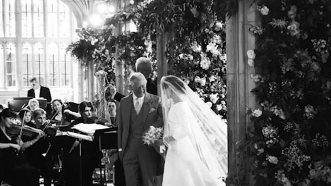 Prince Charles who is seen here about to walk Meghan down the aisle