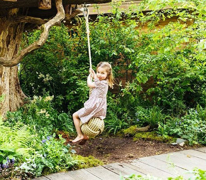 Princess Charlotte enjoyed a swing on the rope in the woodland park