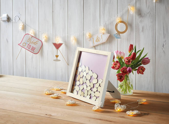 The little wooden guestbook is only £9.99