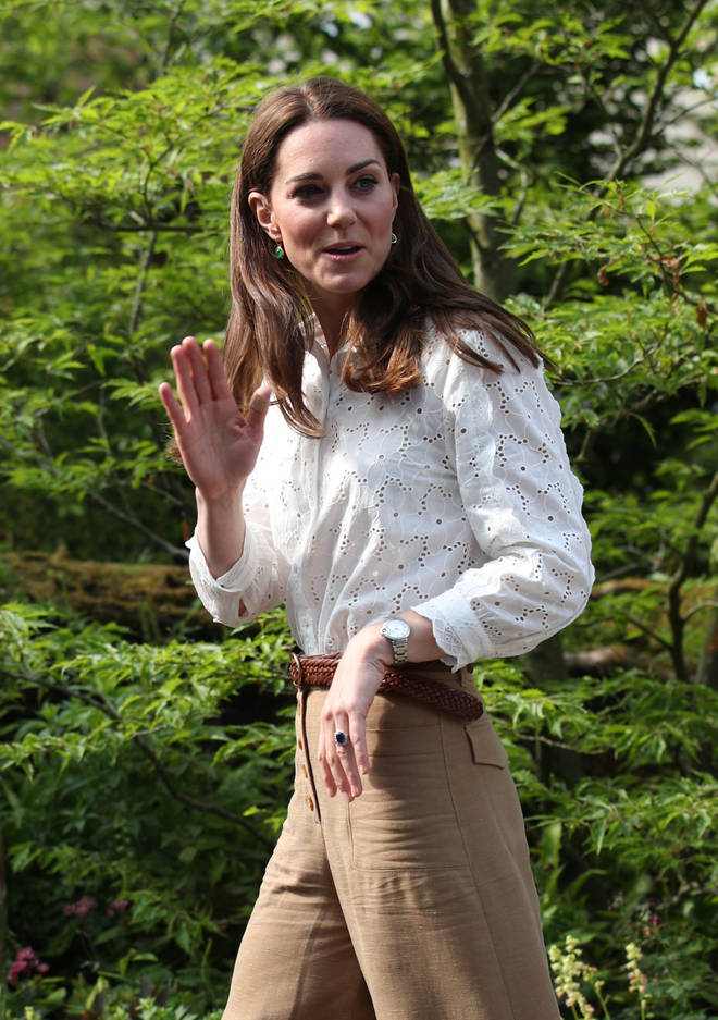 Kate Middleton wore a white shirt teamed with camel trousers