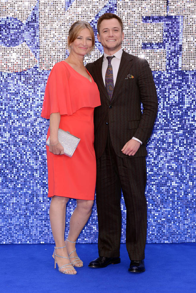 Taron also posed with his mum, Christine, on the blue carpet