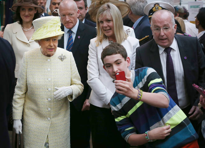 The Queen prefers to see people's faces rather than their phones