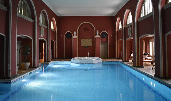 The spa features an ornate swimming pool complete with statues