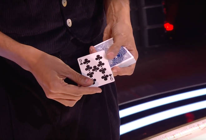 When Simon revealed his hand, the card was gone, which left the judges confused