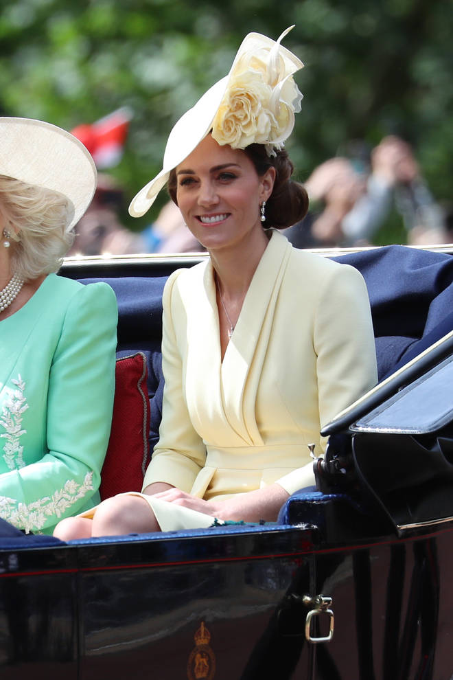 Kate Middleton looked polished in a lemon yellow coat dress and hat.