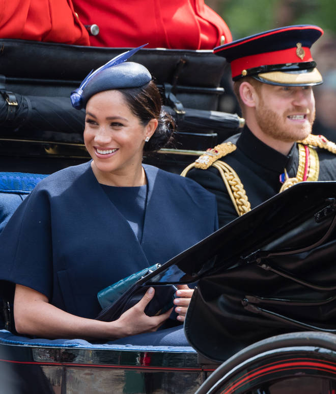 Meghan Markle opted for a matching navy short sleeve dress and wrap jacket by Givenchy for Trooping the Colour.