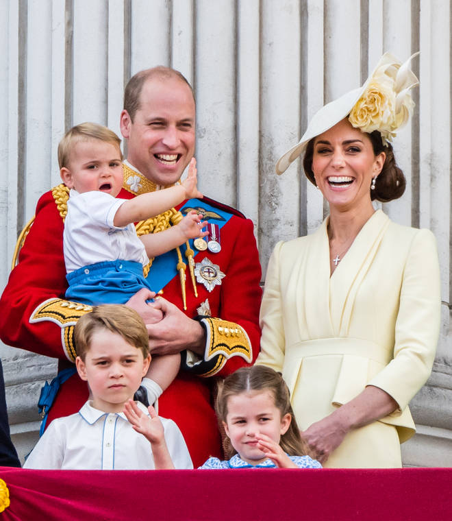 Proud parents Prince William and Kate Middleton gather together on the balcony with their three children Prince Louis, Prince George and Princess Charlotte.