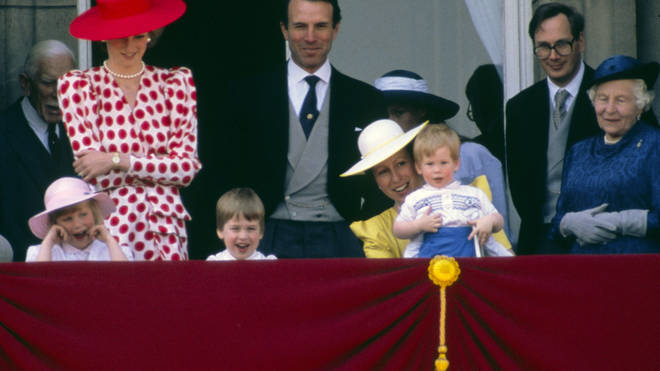Princess Anne holding Prince Harry.