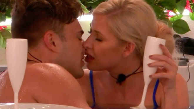 Love Island's power couple Amy and Curtis get steamy in the hot tub