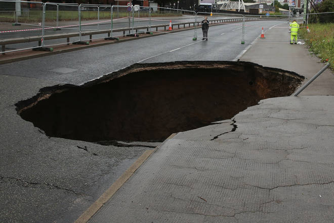 What are sinkholes and what causes them to form?