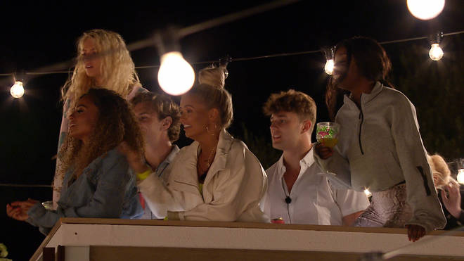The Love Island girls were watching Elma and Maura's dates below, heckling them and laughing