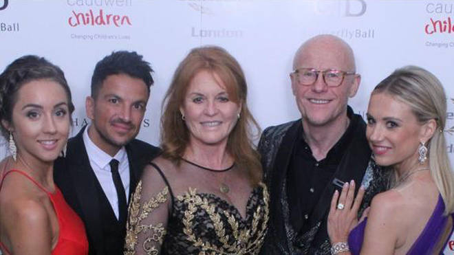 Founder John Caudwell poses with stars, including the Duchess and Peter Andre, at the charity event