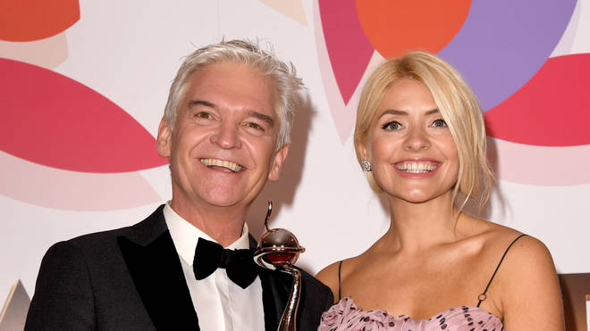 Holly and Phil pose for pictures at the National Television Awards