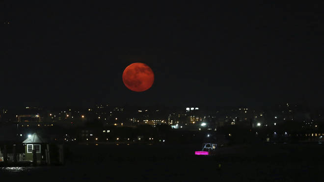The New York City skyline got an impressive view of the Strawberry Moon