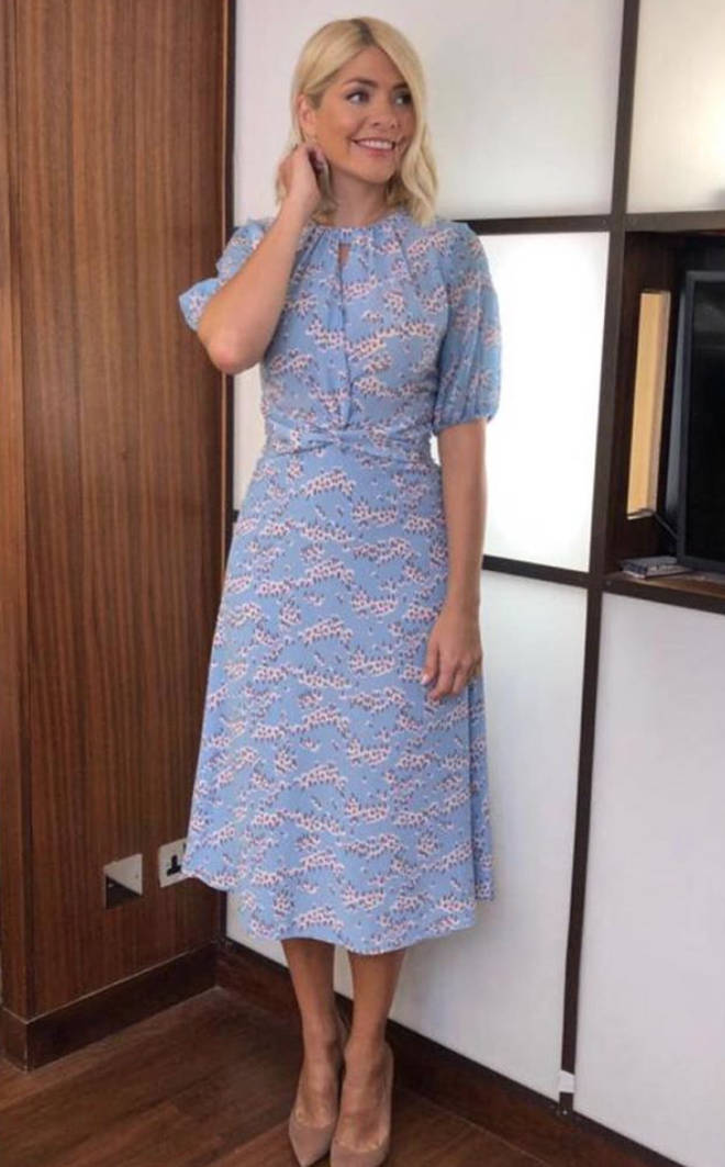Holly, 38, looked fabulous in a floral blue midi dress for the second show of the week