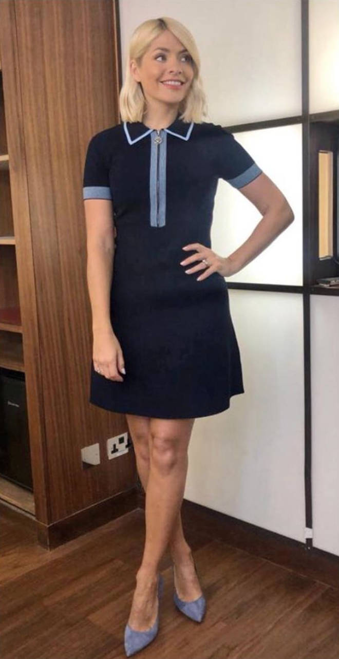 Holly wore a navy mini dress for Monday's show