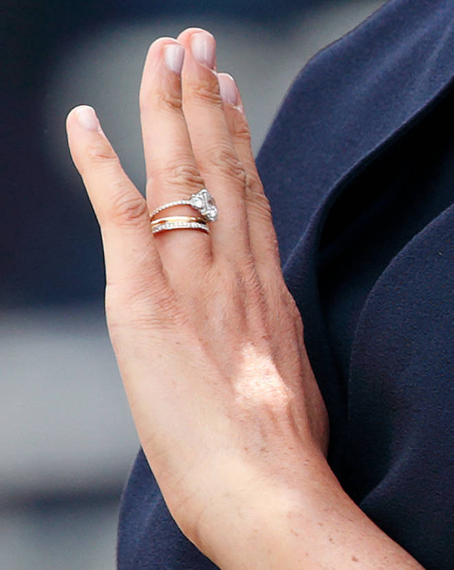 Meghan appears to have re-set the gemstones onto a thin, diamond-studded, micro-pave band.