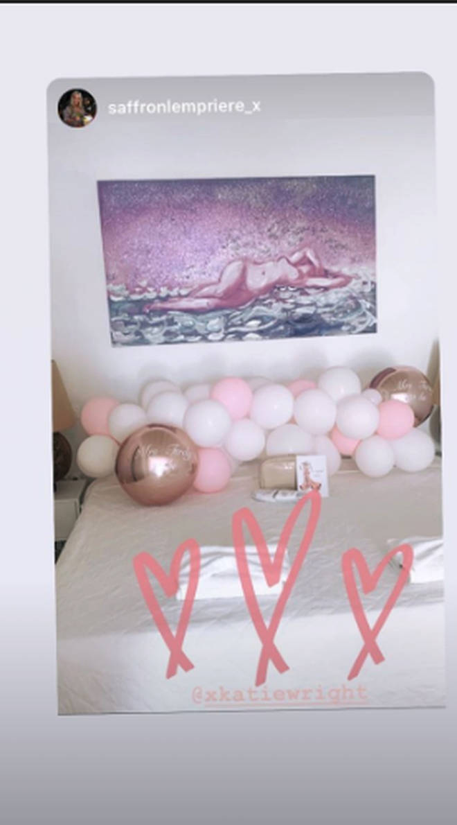 The master bedroom was decorated with pink and white balloons