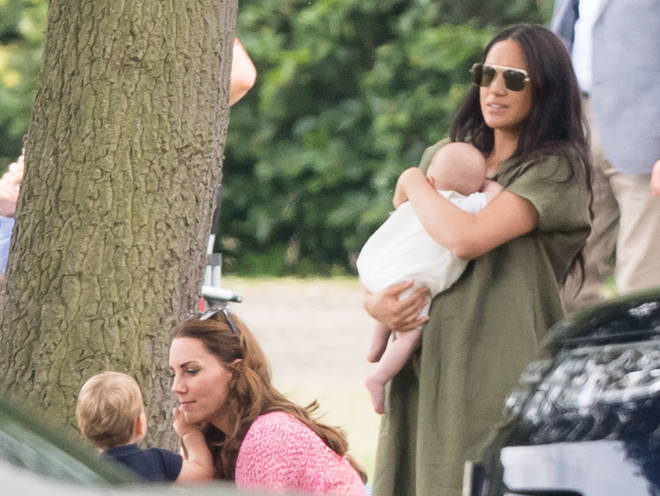 Meghan Markle wore a khaki dress and large sunglasses as she watch Prince Harry play polo