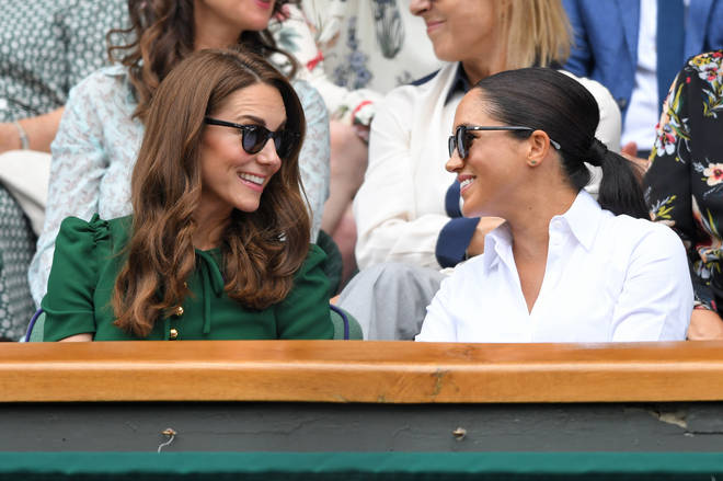 Kate Middleton and Meghan Markle put on a friendly display at the Wimbledon Ladies' Final.